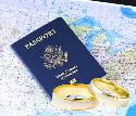 US Passport on top of a map and two wedding bands